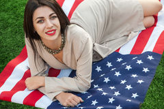 Beautiful sexy young woman with classic dress lying down on amer Royalty Free Stock Photos