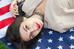 Beautiful sexy young woman with classic dress lying down on amer Royalty Free Stock Image