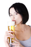 Beautiful and young woman drinking beer Royalty Free Stock Image