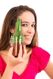 Beautiful and young woman with a beer. Beautiful and young woman drinking beer, isolated on white royalty free stock photo