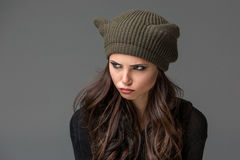 Beautiful sexy young woman in a  funny hat with Royalty Free Stock Photos