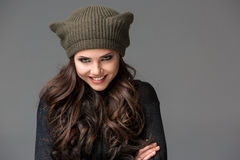 Beautiful sexy young woman in a  funny hat with Royalty Free Stock Photo