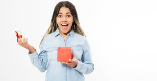 Beautiful young woman holds a small open gift box isolated - Copy space.  royalty free stock photography