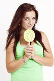 Beautiful and sexy young woman with lollipop Royalty Free Stock Photos