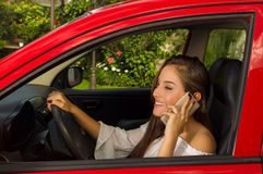 Beautiful sexy young woman making a phone call and smiling.  Stock Image