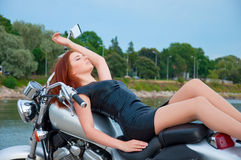 Beautiful, sexy, young woman on a motorcycle Royalty Free Stock Photos