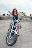 Beautiful, sexy, young woman on a motorcycle. Royalty Free Stock Photo