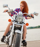 Beautiful, sexy, young woman on a motorcycle Royalty Free Stock Image