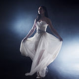 Beautiful sexy young woman. Portrait of girl in long white dress, mystical, mysterious style, dark background Stock Images