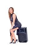 Beautiful sexy young woman posing with audio equipment. Stock Photography