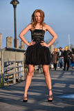Beautiful sexy young woman wearing black dress posing on the street. Royalty Free Stock Photo