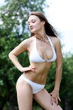 Beautiful sexy young woman in white bikini Stock Photo