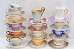 Beautiful shabby chic antique cups stock images