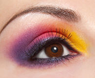Beautiful shape of female eye with violet-yellow Stock Photos