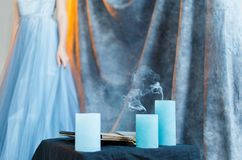 Bride in gown with a candles Royalty Free Stock Photography