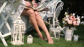 Beautiful shapely legs young woman with book stock video footage