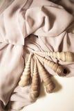 Beautiful shells on white silk drapery Royalty Free Stock Image