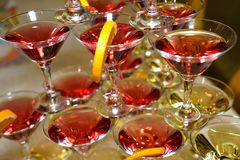 Beautiful shelves of glasses of red and white wine Stock Photo