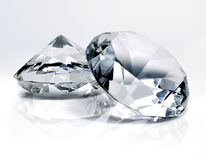 Beautiful shiny diamonds, on white background. Clear or transparent diamonds, close-up shot stock photos