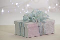 Beautiful  shiny gift box. On the table Royalty Free Stock Photos
