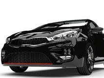 Beautiful shiny midnight black modern electric car - front view extreme closeup shot Royalty Free Stock Images