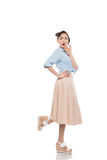 Beautiful shocked asian girl in skirt and blouse looking away Stock Photos