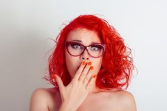 Beautiful shocked surprised woman girl with glasses, covering mouth with hand royalty free stock image