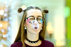Pink: Girl Blowing Big Bubble with Copyspace royalty free stock image
