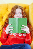 Beautiful shocked young woman reading book Royalty Free Stock Photos