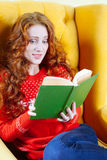 Beautiful shocked young woman reading book Royalty Free Stock Photo