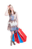 Beautiful shopaholic tired of shopping carrying a lot of bags Stock Image