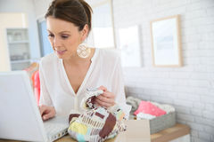 Beautiful shopgirl working in a store Stock Photography