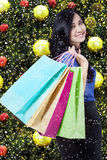 Beautiful shopper with christmas ornament Stock Images