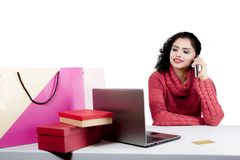 Beautiful shopper with smartphone and laptop Royalty Free Stock Image