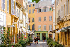 Beautiful shopping area Provence with tourists shopping. AIX-EN-PROVENCE, FRANCE - JUL 17, 2014: Beautiful shopping area in Aix-En-Provence with tourists walking Stock Images