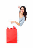 Beautiful shopping Christmas woman with bag. Royalty Free Stock Photo