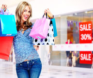 Beautiful shopping Christmas woman with bags. Royalty Free Stock Photos