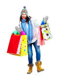 Beautiful shopping Christmas woman with bags. Royalty Free Stock Images