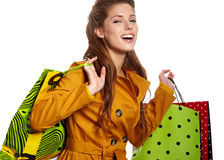 Beautiful shopping woman. Happy holding shopping bags Royalty Free Stock Image