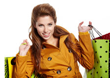 Beautiful shopping woman. Happy holding shopping bags Stock Image