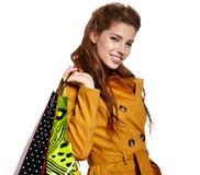 Beautiful shopping woman. Happy holding shopping bags Royalty Free Stock Photography