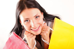 Beautiful shopping woman happy holding bags. Beautiful shopping woman happy holding paper bags Stock Photo