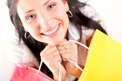 Beautiful shopping woman happy holding bags. Beautiful shopping woman happy holding paper bags Royalty Free Stock Photography