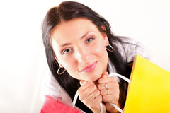 Beautiful shopping woman happy holding bags. Beautiful shopping woman happy holding paper bags Royalty Free Stock Images