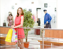 Beautiful shopping woman holding bags at a mall Stock Image