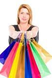 Beautiful shopping woman holding shopping bags Stock Photography