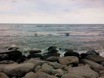Beautiful Shore of Caspian Sea. And Its rocky shore with beautiful waves royalty free stock photo
