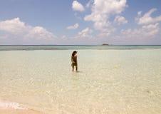 Beautiful shore in Karimunjawa island with girl that walk in the water. Indonesia Royalty Free Stock Photos