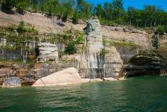 Beautiful shore of Superior Lake near Munising, Michigan, USA. Painted rocks at Pictured Rocks National Lakeshore, Michigan, USA stock image