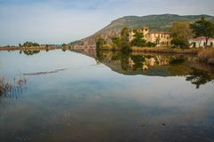 Beautiful shores of Kaifa lake and old ruined buildings and their reflections in water on Peloponnese in Greece. Image of beautiful shores of Kaifa lake and old royalty free stock images